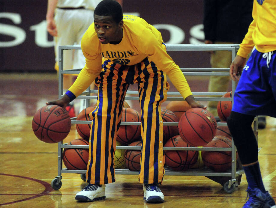 Best outfit by Presidents in office.The Harding basketball team has great uniforms and the best warm-ups in the state. Blue, gold, and wide piping makes for a classic and unique style. Photo: Christian Abraham / Connecticut Post