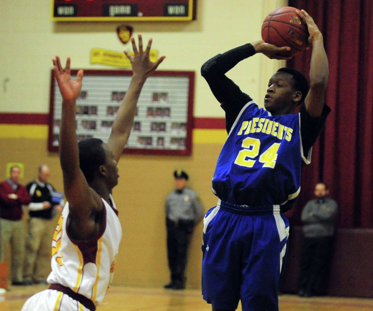 Harding's Reggie Stewart attempts a shot, during boys basketball action against St. Joseph in Trumbull, Conn. on Friday January 24, 2014.
