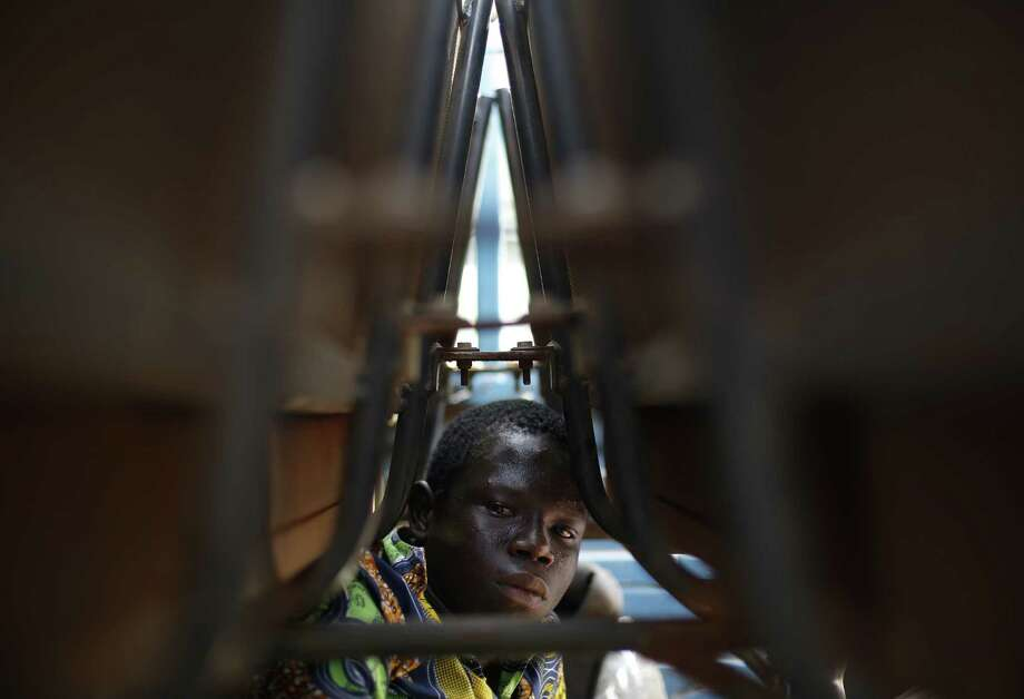 A looting suspect is detained in a mosque in downtown Bangui, Central African Republic. U.N. officials have warned sectarian fighting there could escalate into genocide. Photo: Jerome Delay / Associated Press / AP