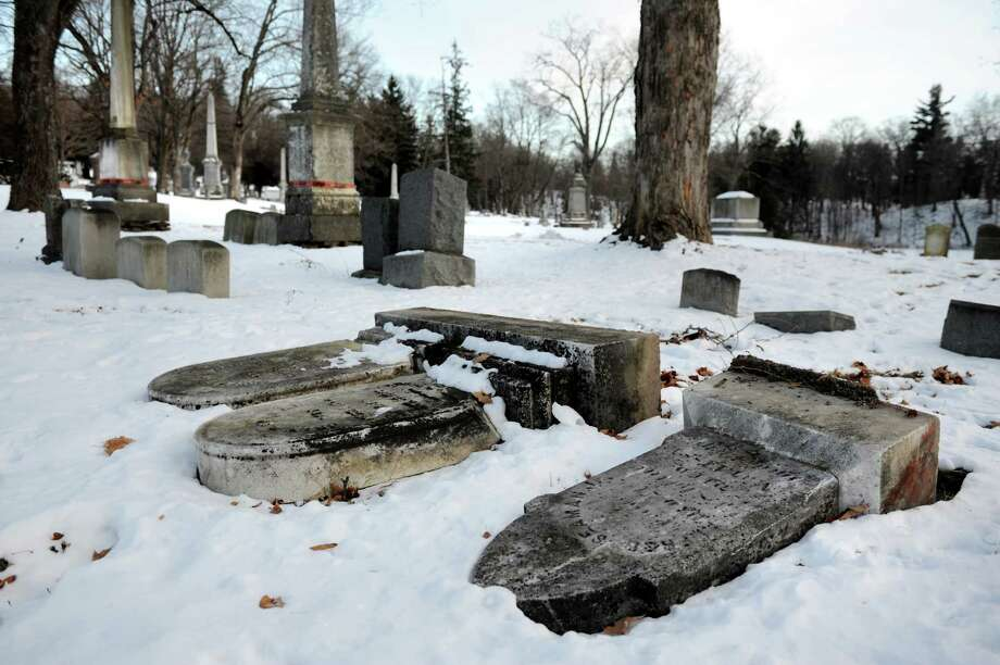 Toppled headstones on Friday, Jan. 24, 2014, at Oakwood Cemetery in Troy, N.Y. (Cindy Schultz / Times Union) Photo: Cindy Schultz / 00025501A