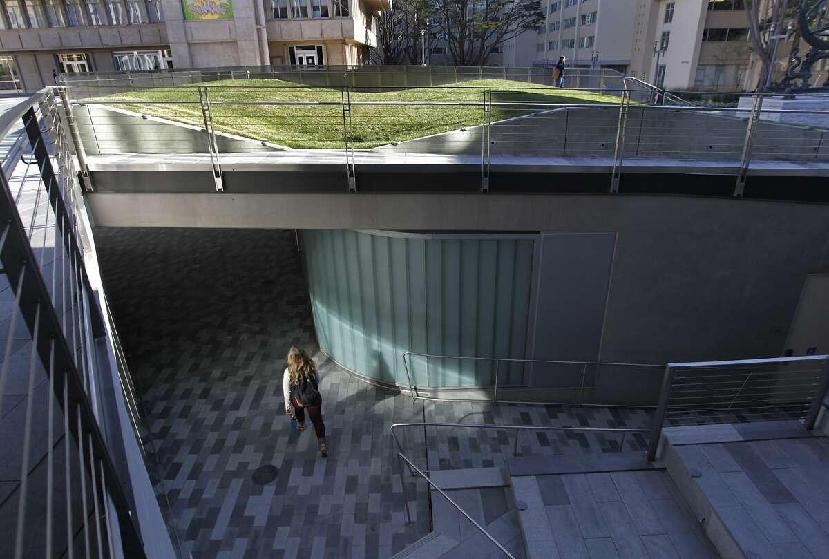 A student strolls into the lower level of USF's new John Lo Schiavo, S.J., Center for Science and Innovation. The design resourcefully maximizes the limited space of its urban setting by flowing below ground level.