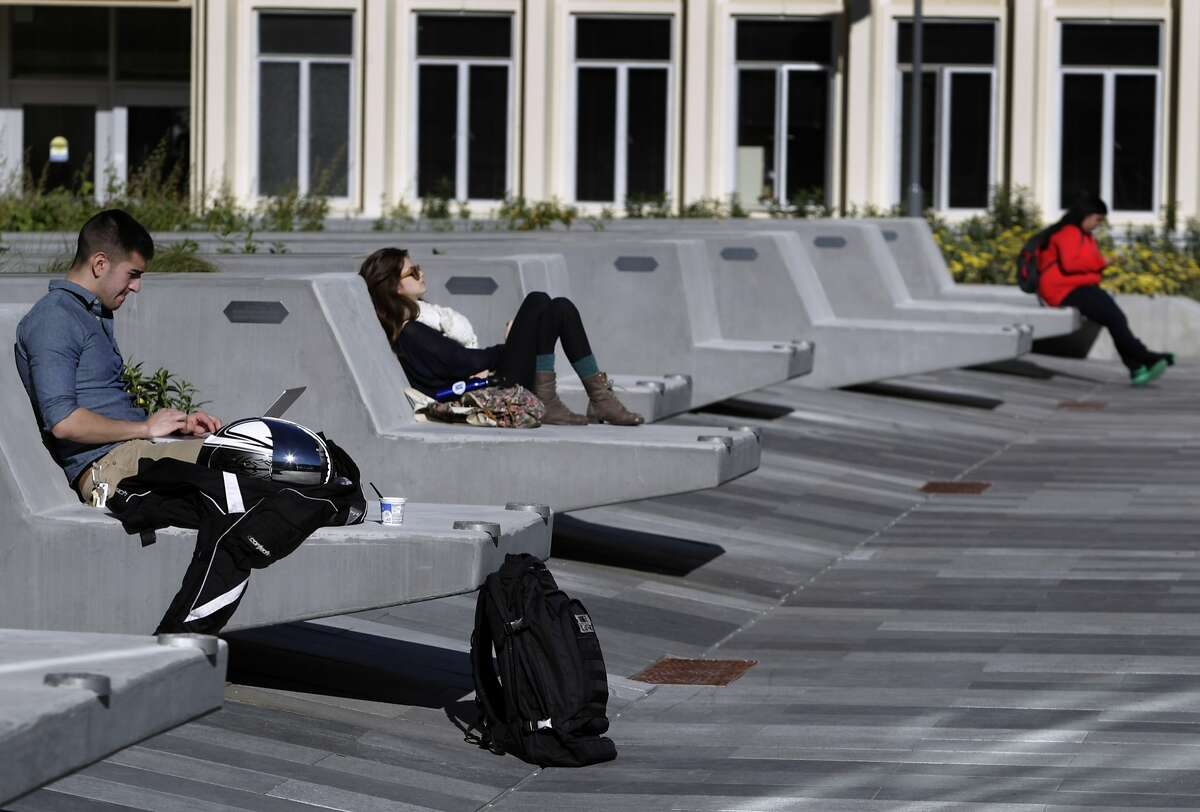 Will Gomez (left) and fellow students relax on a plaza next to the new center, where the public spaces have adapted well to university life.