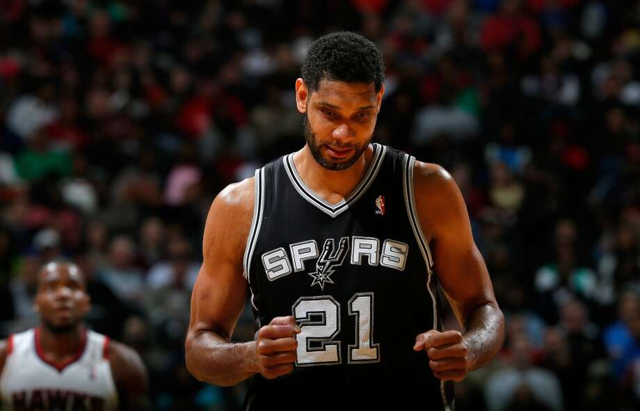 ATLANTA, GA - JANUARY 24:  Tim Duncan #21 of the San Antonio Spurs reacts after a basket against the Atlanta Hawks at Philips Arena on January 24, 2014 in Atlanta, Georgia.  NOTE TO USER: User expressly acknowledges and agrees that, by downloading and or using this photograph, User is consenting to the terms and conditions of the Getty Images License Agreement.  (Photo by Kevin C. Cox/Getty Images) Photo: Kevin C. Cox, Getty Images
