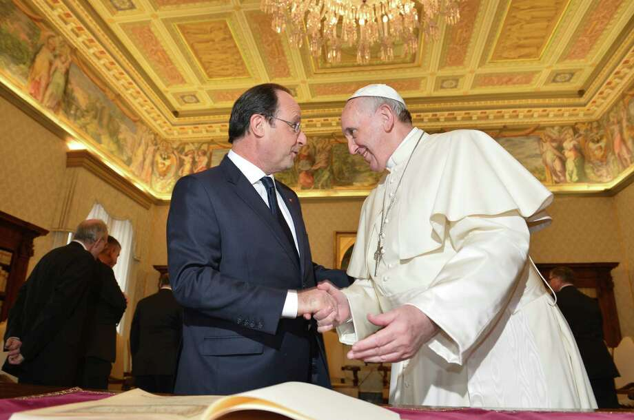 French President Francois Hollande met with Pope Francis amid tensions in his private life over an alleged affair. Photo: Associated Press / POOL AFP
