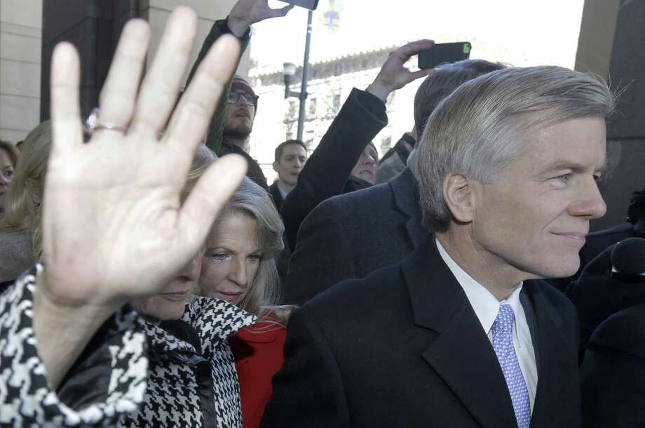 Former Virginia Gov. Bob McDonnell and his wife, Maureen (behind him), pleaded not guilty to federal charges. Photo: Steve Helber / Associated Press / AP