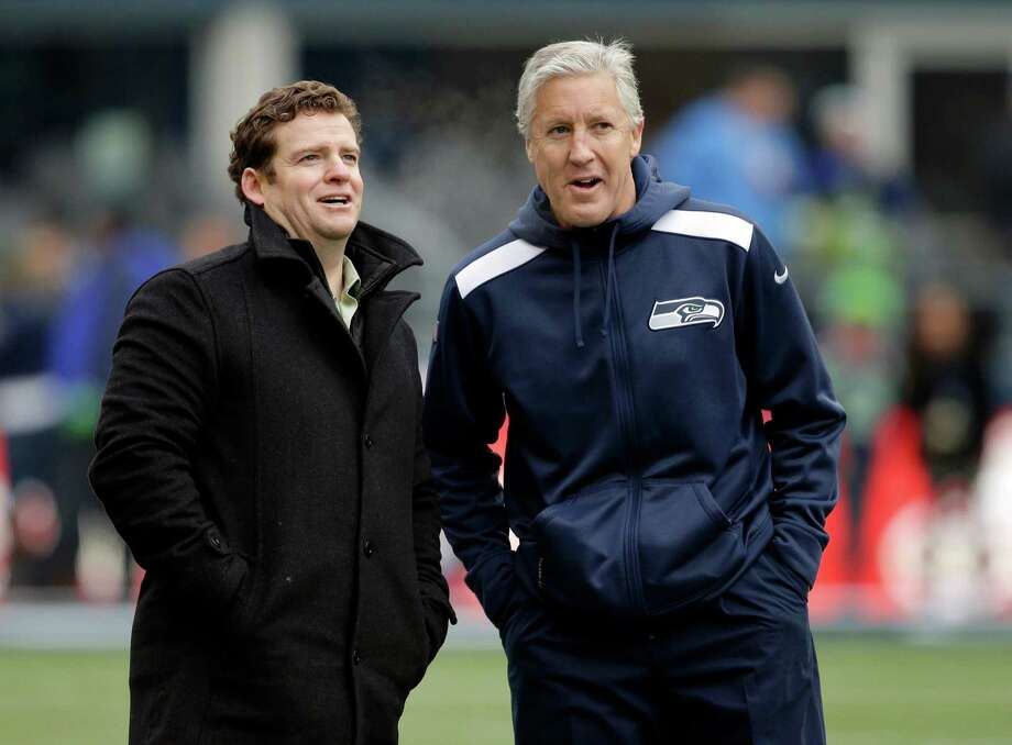 General manager John Schneider, left, and coach Pete Carroll have formed a cohesive partnership to stockpile the Seahawks' roster with an abundance of talent. Photo: Elaine Thompson, STF / AP