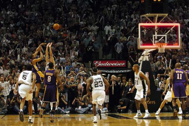 Derek Fisher, for his buzzer beater with 0.4 seconds to go in the 2004 conference semifinals with the Lakers ... right after Tim Duncan shot a three-pointer to take the lead. Spurs fans LOATHE Fisher.PHOTO: Fisher launches the game-winning shot as the clock runs out of time over the defense of the Spurs' Manu Ginobili to win Game 5 of the Western Conference Semifinals 74-73 at the SBC Center on May 13, 2004.