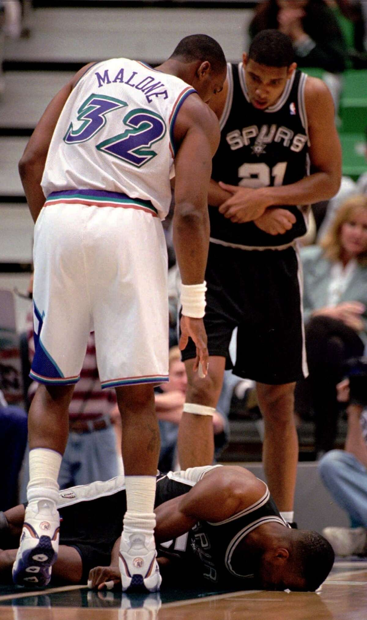 Remember the Elbow! In 1998, Utah Jazz great Karl Malone knocked out David Robinson with his elbow. Robinson got a concussion. Malone got eternal hatred in San Antonio. To add insult to injury, a month after Malone sent the Admiral to the hospital, he knocked the Spurs out of the postseason. PHOTO: The Spurs' Robinson hits the floor and is knocked out cold as teammate Tim Duncan (21) and the Jazz's Malone look on in the first few minutes of the first quarter on April 8, 1998. Robinson was revived and taken to a local hospital, with a possible concussion, for a CAT scan.