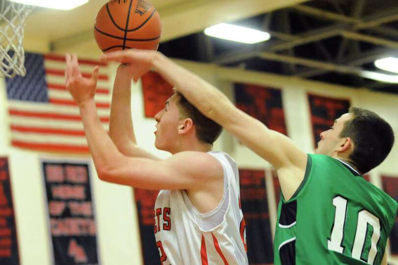 Academy's Matt Knezovic, left, tries to shoot as Bishop Ludden's Tim Rooney defends during their bas