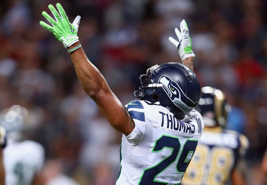 Safety Earl Thomas Like Sherman, Thomas was voted a first-team All-Pro. But unlike his Legion of Boom compatriot, the quiet Thomas makes the most noise with the way he plays the game. A quintessential ball hawk, Thomas is nearly always in the right place to make the right play. Taken in the first round in Pete Carroll's first year as head coach, Thomas's development into an elite player has mirrored the Hawks progression into an elite team. Photo: Andy Lyons, Getty Images
