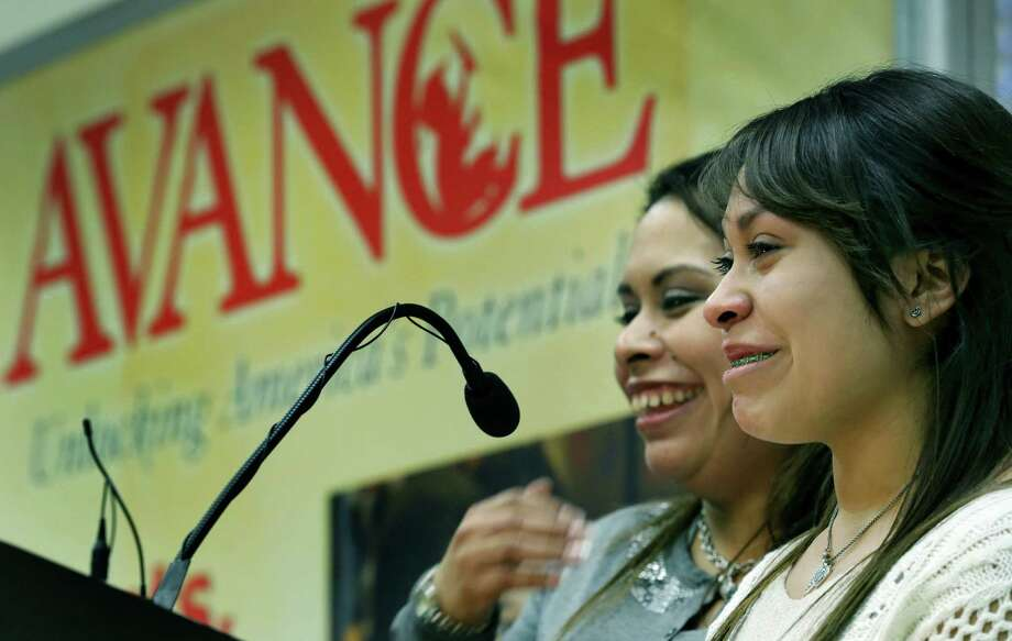 Emily Huerta (right), 16, cries tears of gratitude as her mother, Elizabeth Reyes, tells of their accomplishments through Avance programs the two entered when she was 18. Photo: Bob Owens / San Antonio Express-News / © 2012 San Antonio Express-News