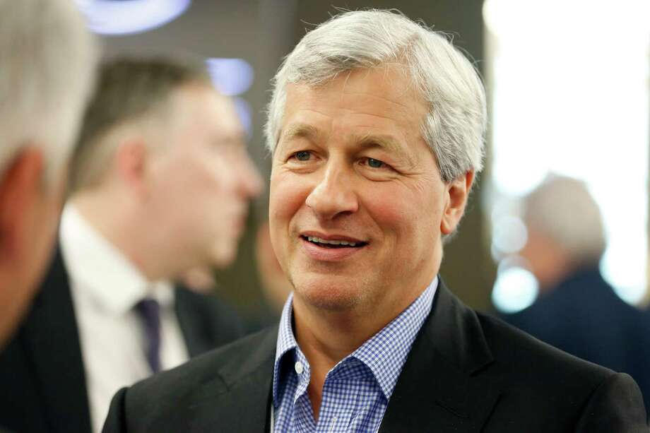 James 'Jamie' Dimon, chief executive officer of JPMorgan Chase & Co., speaks with delegates during a break in sessions on the opening day of the World Economic Forum (WEF) in Davos, Switzerland, on Wednesday, Jan. 22, 2014. World leaders, influential executives, bankers and policy makers attend the 44th annual meeting of the World Economic Forum in Davos, the five day event runs from Jan. 22-25. Photographer: Jason Alden/Bloomberg *** Local Caption *** James Dimon Photo: Jason Alden / Copyright 2014 Bloomberg Finance LP, All Rights Reserved.