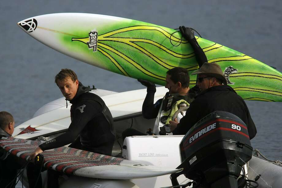 A group of surfers pull their boards into a zodiac before the start of the 2014 Maverick's Invitational surf contest held in Half Moon Bay, CA, Friday, January 24, 2014. Photo: Michael Short, The Chronicle
