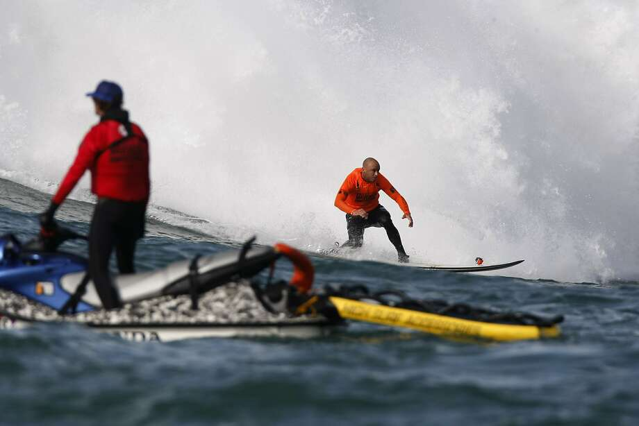 Shane Dorian rides out of a wave during the Finals of the 2014 Maverick's Invitational surf contest held in Half Moon Bay, CA, Friday, January 24, 2014. Photo: Michael Short, The Chronicle