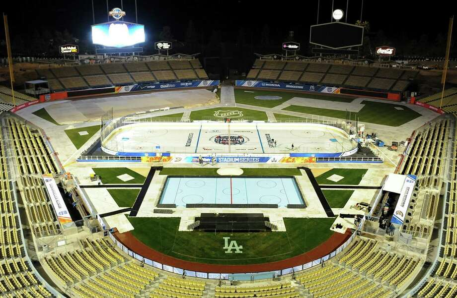 Dodger Stadium is the setting for Saturday night's game between the Los Angeles Kings and Anaheim Ducks. The forecast for the 8:30 p.m. start is clear skies, temperatures in the low 60s and little wind. The small rink is for ball hockey. Photo: Wally Skalij, MBR / Los Angeles Times
