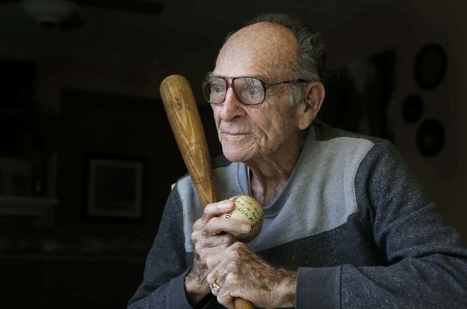 Former baseball player Neill Sheridan holds the very baseball and bat that he hit a 613 foot home run with back in 1953, as seen on Tuesday Jan. 21,  2014, at the home of his granddaughter in Antioch, Calif. Former professional  baseball player Neill Sheridan is credited with hitting the longest home run at the time back in 1953, a measured 613 feet. Photo: Michael Macor, The Chronicle