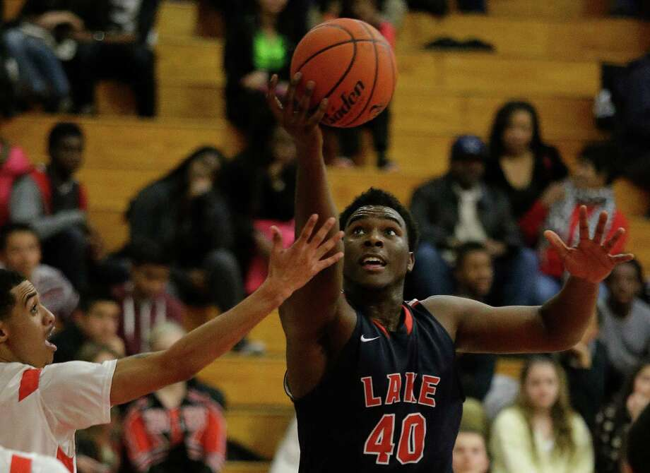 Center Jordan Davis was a force for Clear Lake on Friday. He had 20 rebounds to go with 17 points, including a pair of late putbacks, to help topple Clear Brook. Photo: J. Patric Schneider, Freelance / © 2014 Houston Chronicle