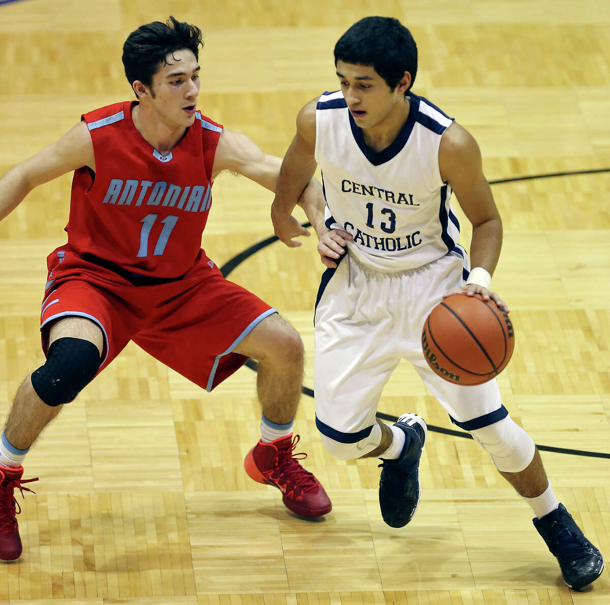 Central Catholic's Paul Escobar looks for room around Antonian's Alec Boggess during first half action Friday Jan. 24, 2014 at Greehey Arena on the St. Mary's University campus.