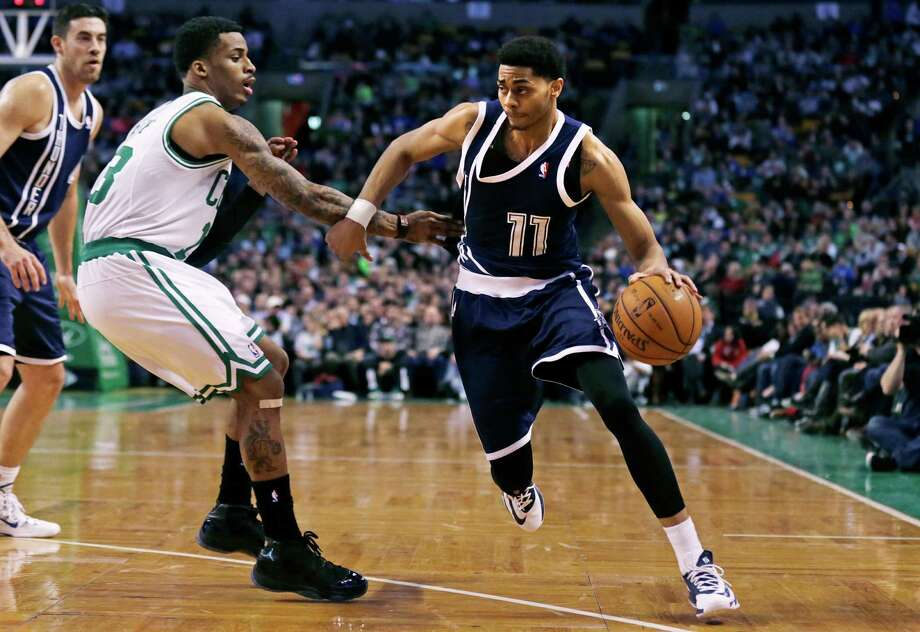 Oklahoma City Thunder guard Jeremy Lamb (11) drives to the basket against Boston Celtics guard Vander Blue, left, during the second half of an NBA basketball game in Boston, Friday, Jan. 24, 2014. The Thunder defeated the Celtics 101-83. (AP Photo/Charles Krupa) ORG XMIT: MACK111 Photo: Charles Krupa / AP