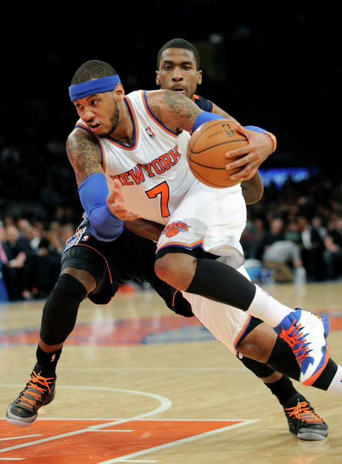 Carmelo Anthony (7) blew by Michael Kidd-Gilchrist and the Bobcats to the tune of 62 points Friday. Photo: Bill Kostroun, FRE / FR51951 AP
