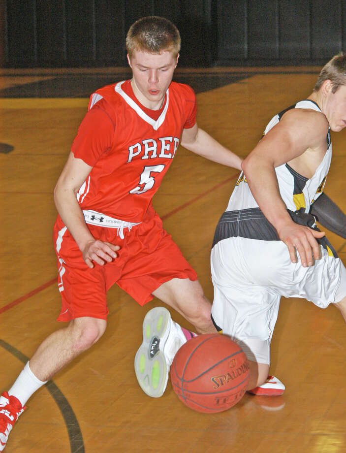 Tommy Nolan, of Fairfield Prep, making a steal against Amity on Friday, Jan. 24 in an SCC boys basketball game in Woodbridge. The Jesuits, rated No. 1 in the state, won by 83-52 to improve to 12-0. Photo: Andy Hutchison / Fairfield Citizen