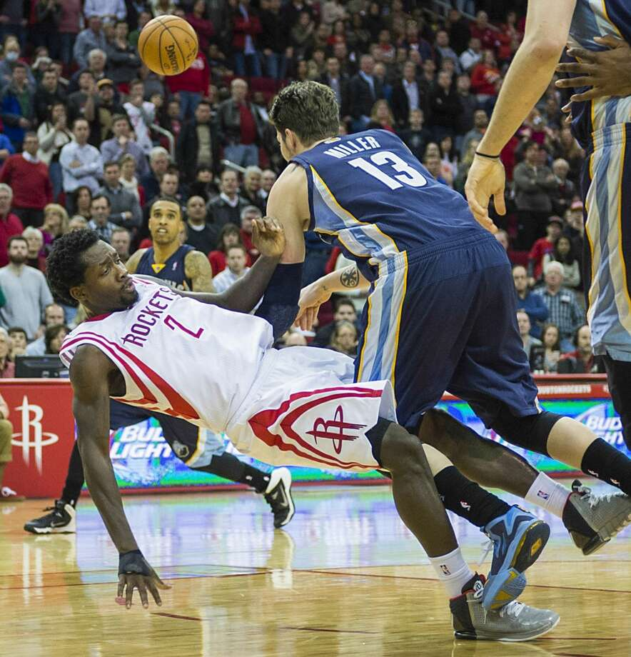 Rockets point guard Patrick Beverley (2) draws a charge from Grizzlies small forward Mike Miller (13) with 8.3 seconds left to play. Photo: Smiley N. Pool, Houston Chronicle
