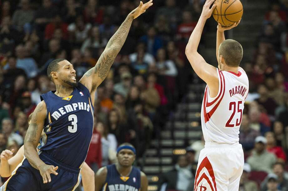 Rockets small forward Chandler Parsons (25) shoots over Grizzlies power forward James Johnson (3) to sink his 10th 3-pointer of the second half. Photo: Smiley N. Pool, Houston Chronicle
