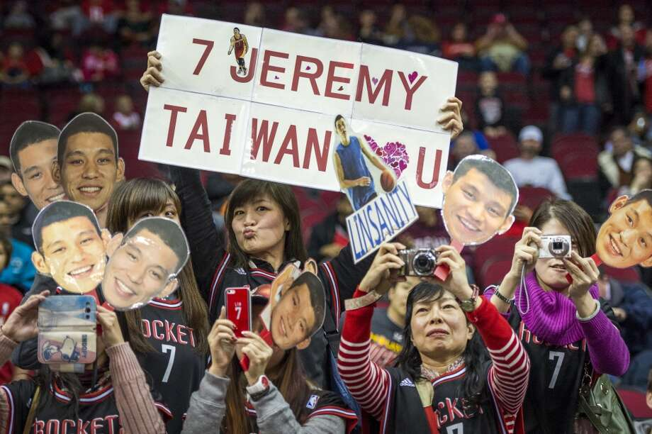 A group of fans cheer for Rockets point guard Jeremy Lin. Photo: Smiley N. Pool, Houston Chronicle