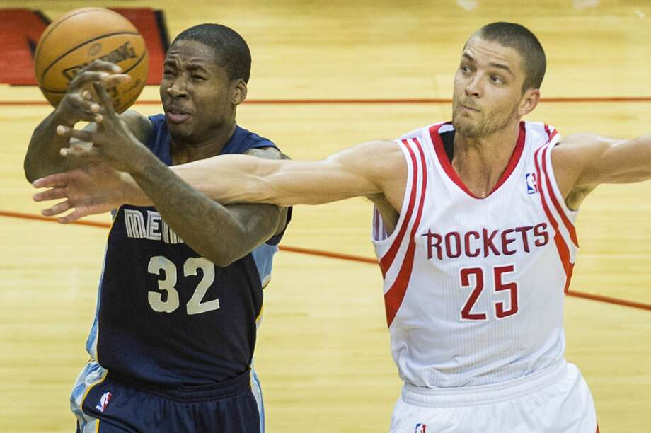 Rockets small forward Chandler Parsons knocks the ball away from Grizzlies power forward Ed Davis. Photo: Smiley N. Pool, Houston Chronicle