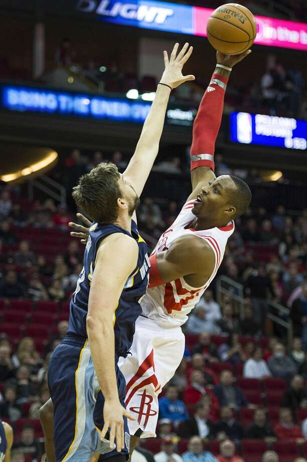 Rockets center Dwight Howard shoots over Grizzlies center Marc Gasol. Photo: Smiley N. Pool, Houston Chronicle