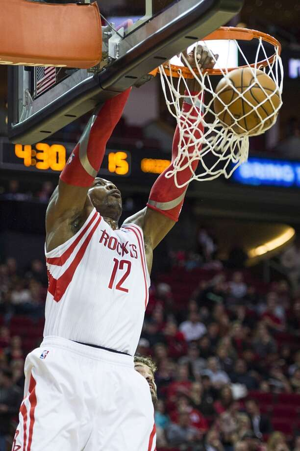 Rockets center Dwight Howard goes up for a dunk during the first half. Photo: Smiley N. Pool, Houston Chronicle