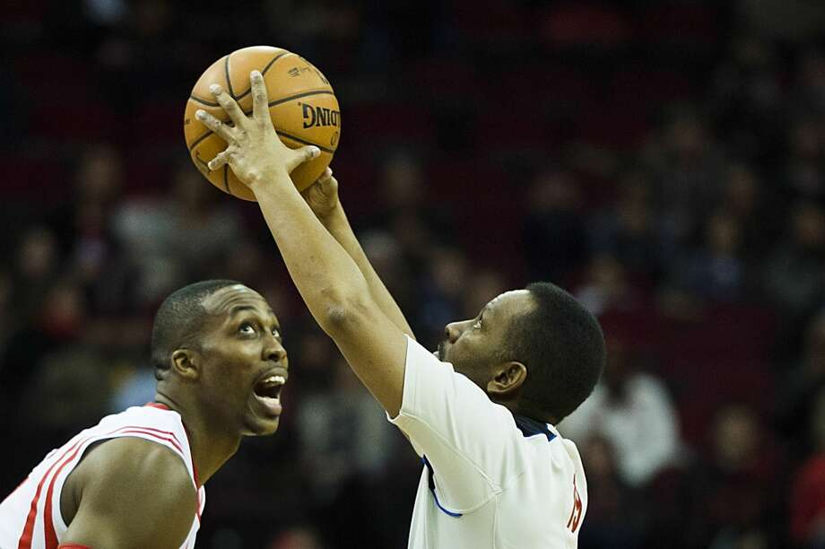 Rockets center Dwight Howard eyes the opening tipoff. Photo: Smiley N. Pool, Houston Chronicle