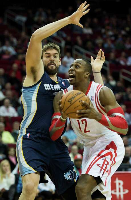 Rockets center Dwight Howard has a chance to exceed his 11 points in a rematch with Memphis on Saturday. Photo: Smiley N. Pool, Staff / © 2014  Houston Chronicle