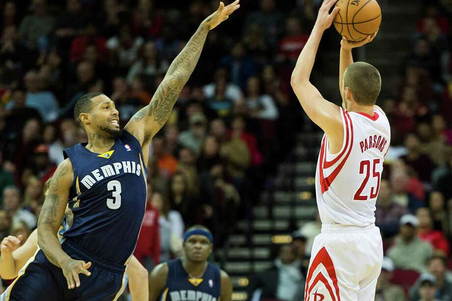 Rockets forward Chandler Parsons, right, finds the Grizzlies' James Johnson to be of little distraction to his record 10th 3-pointer. Photo: Smiley N. Pool, Staff / © 2014  Houston Chronicle