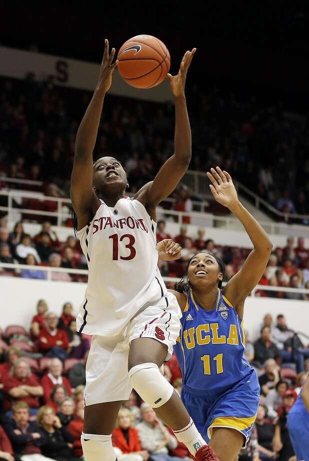 Chiney Ogwumike grabs a lob pass in front of UCLA's Atonye Nyingifa. Photo: Marcio Jose Sanchez, Associated Press