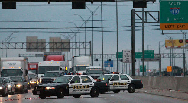 Cars exit northbound Interstate 35 as police divert traffic at Walzem Road because of ice accumulation on bridges. Parts of every major highway in and out of the city were affected. Photo: John Davenport / San Antonio Express-News / ©San Antonio Express-News/Photo may be sold to the public