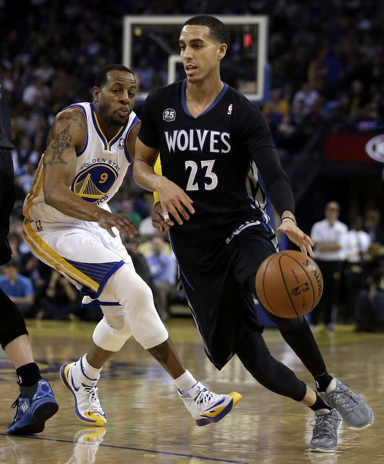 Kevin Martin (23), who scored 26 points, drives past Andre Iguodala. Photo: Ben Margot, Associated Press