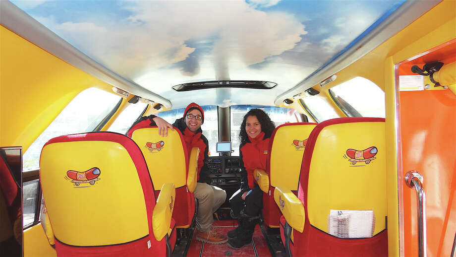 "Oscar Mayer ""hot doggers"" Mike Tierney and Amanda Vazquez at the wheel of the Wienermobile during a Friday visit to Super Stop & Shop on Villa Avenue. Photo: Mike Lauterborn / Fairfield Citizen contributed"