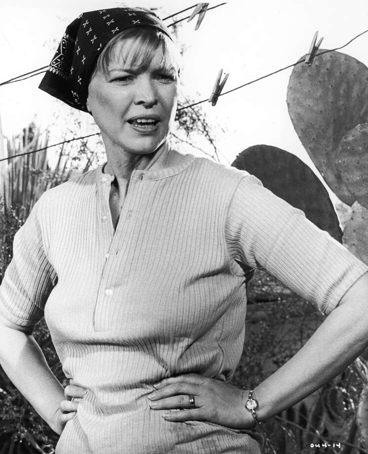 In this movie, directed by Martin Scorsese, a recently-widowed woman who hits the road with her son to find a new life. Here, Ellen Burstyn wears a bandana on her head and stands with her hands on her hips in front of a clothesline. The movie later inspired a TV series called 'Alice.' Photo: Warner Bros./Getty Images, Getty Images / Moviepix