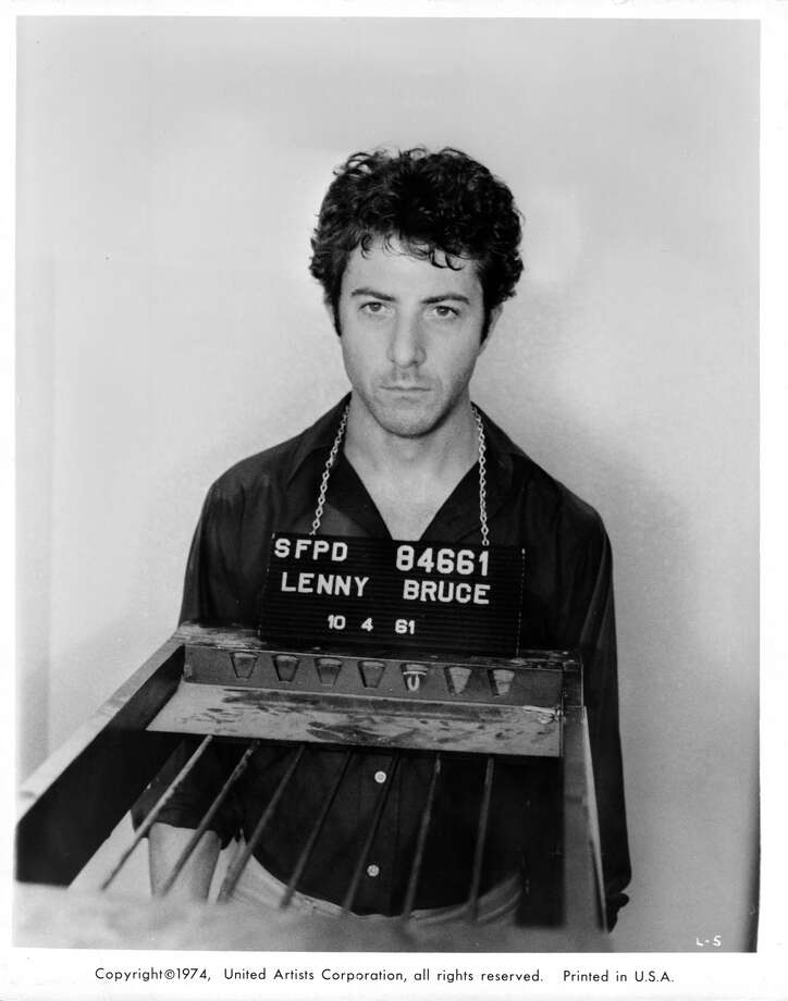 Here we see Dustin Hoffman in a mug shot scene from the biographical film 'Lenny.' This movie is about the 1960s comedian Lenny Bruce, whose out-of-the-box style was sometimes considered obscene.
