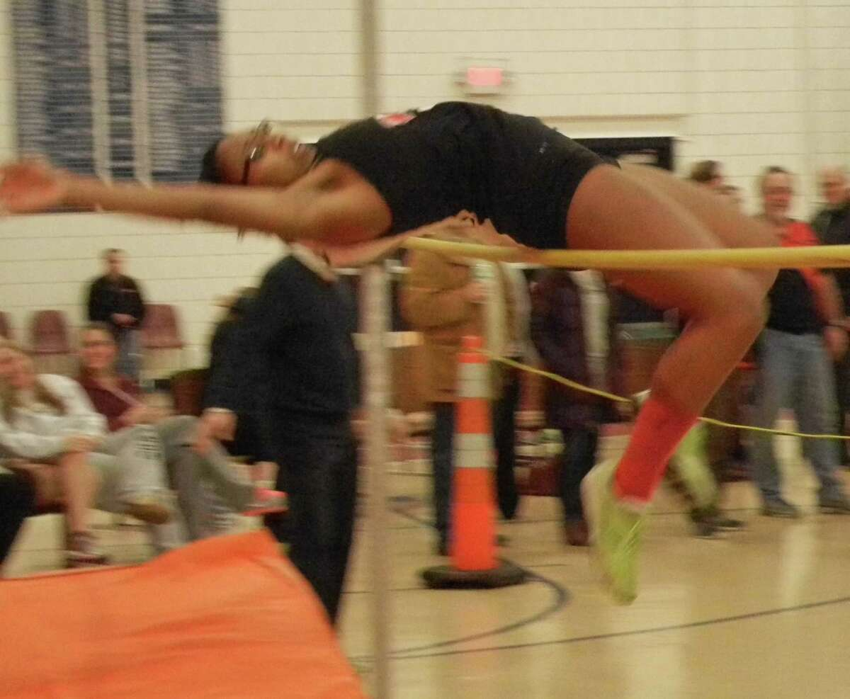 Fairfield Warde senior co-captain Blossom Jean-Jacques competing in the high jump event she won at the FCIAC East divisional championshp meet on Friday, Jan. 24 at the Zeoli Fieldhouse in Wilton.