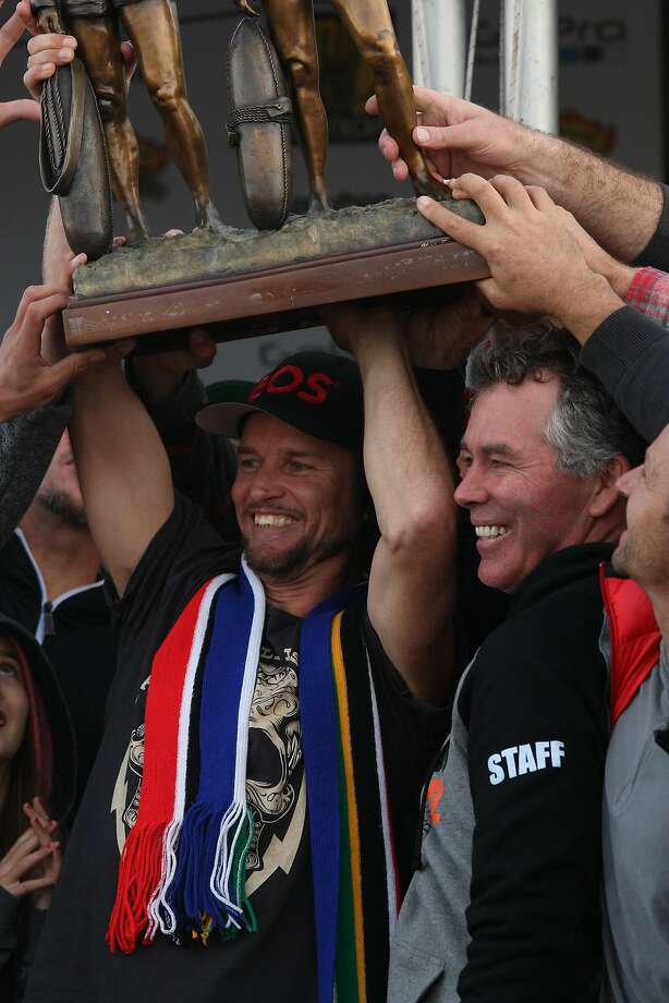 2014 champion Grant Baker getting raising the Marconi Brothers trophy at the Mavericks Invitational Big Wave Surfing Contest Festival in Half Moon Bay, Calif. on Friday, Jan 24, 2014. Photo: Andre Zandona, The Chronicle