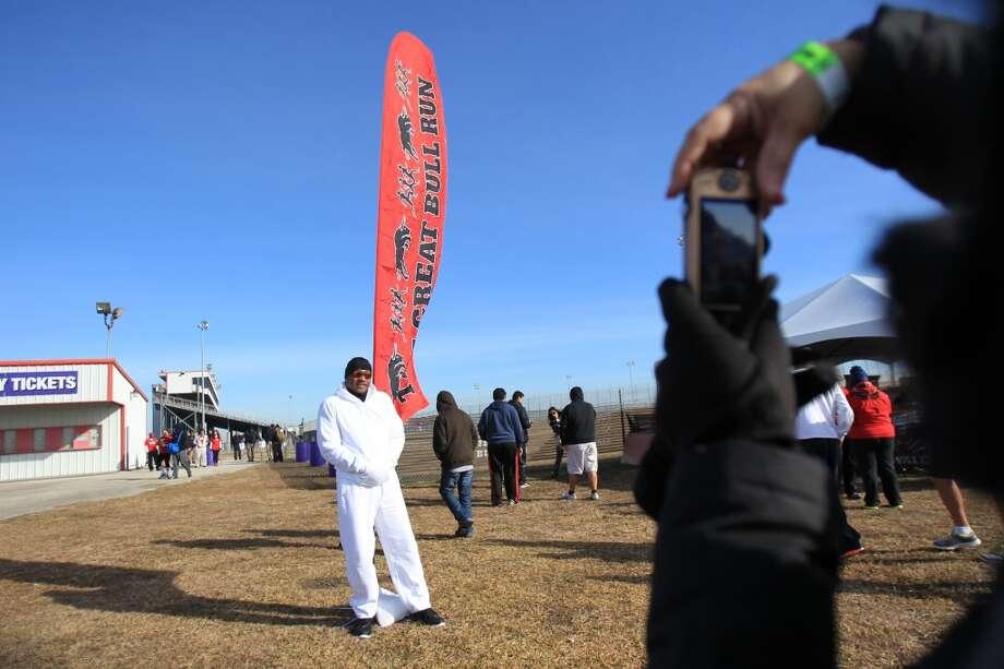 Rene Esquibel arrives to The Great Bull Run at Baytown Race Track on Jan. 25, 2014. ( Mayra Beltran / Houston Chronicle )