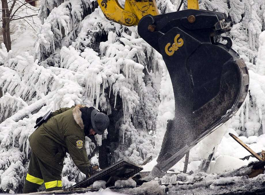 Emergency workers contend with ice up to 2 feet thick as they continue the search for victims of a fatal fire at a seniors home in L'Isle-Verte, Quebec. Thirty-two people are presumed dead. Photo: Ryan Remiorz, Associated Press