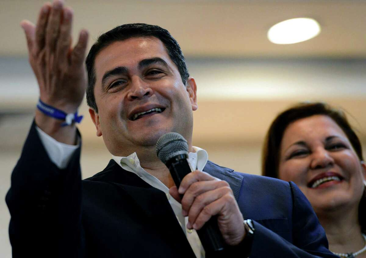 Honduras' ruling right-wing National Party president-elect Juan Orlando Hernández answers questions in November from the press in Tegucigalpa.
