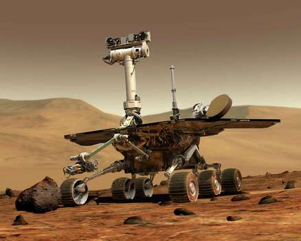 SLIDESHOW: Weird things spotted on Mars by NASA's rovers ...This artist rendering released by NASA shows the NASA rover Opportunity on the surface of Mars. Opportunity landed on the red planet on Jan. 24, 2004 and is still exploring. Its twin Spirit stopped communicating in 2010. (AP Photo/NASA) Photo: HOPD / NASA