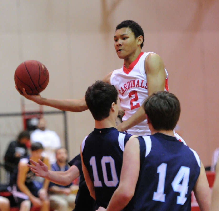 In Greenwich, the boys basketball team tried to keep its perfect season rolling. The Cardinals met the Wilton Warriors on Friday night. Photo: Bob Luckey / Greenwich Time