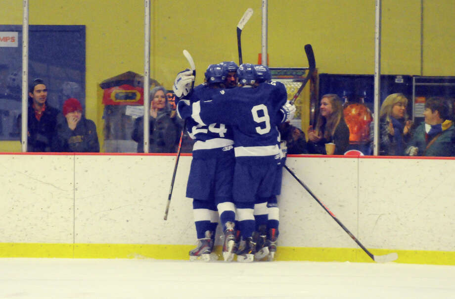 Darien players celebrate a goal as Darien and Trinity Catholic High Schools face off in a boys hockey game at Terry Conners Rink in Stamford, Conn., Jan. 25, 2014. Photo: Keelin Daly / Stamford Advocate Freelance
