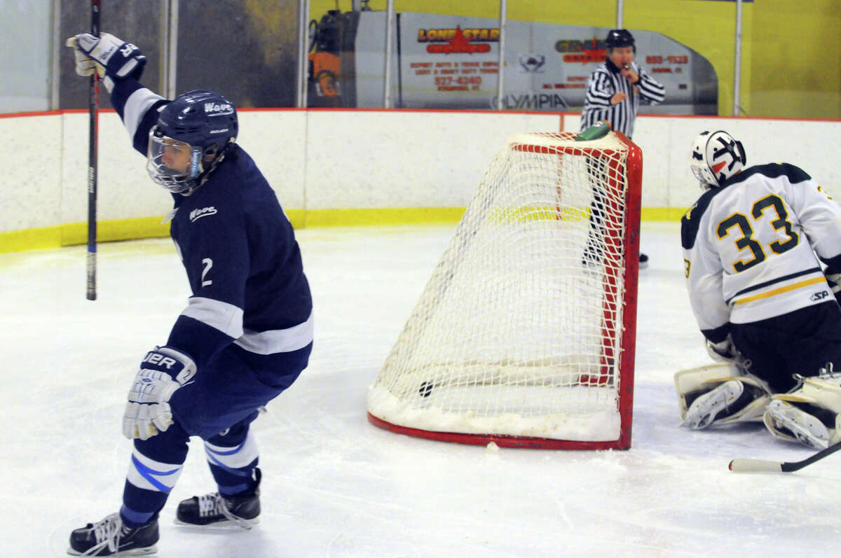 Darien Nicholas Allam reacts after putting the puck in the net as Darien and Trinity Catholic High Schools face off in a boys hockey game at Terry Conners Rink in Stamford, Conn., Jan. 25, 2014.