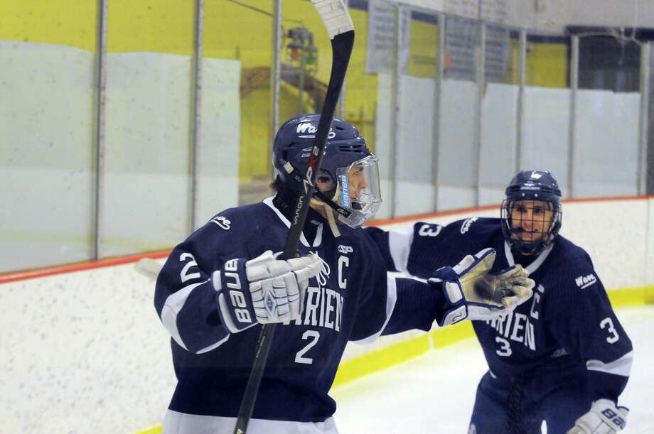 Darien Nicholas Allam, left, and Thomas Watters celebrate Allam's goals as Darien and Trinity Catholic High Schools face off in a boys hockey game at Terry Conners Rink in Stamford, Conn., Jan. 25, 2014. Photo: Keelin Daly / Stamford Advocate Freelance